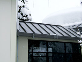 WarmQuest's roof deicing melts ice dams from underneath metal roof coverings
